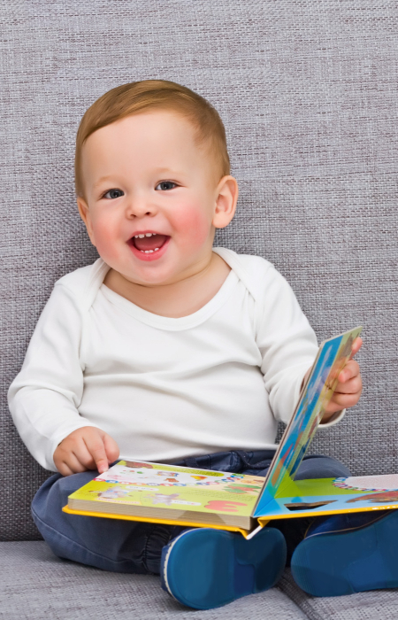 Simon reading at age 2